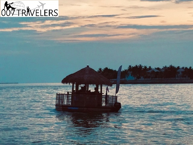 This image has an empty alt attribute; its file name is Key-West-hotel-sunset-boat.jpg