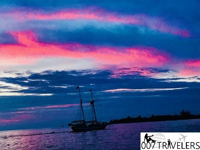 This image has an empty alt attribute; its file name is Key-West-sunset-boat.jpg